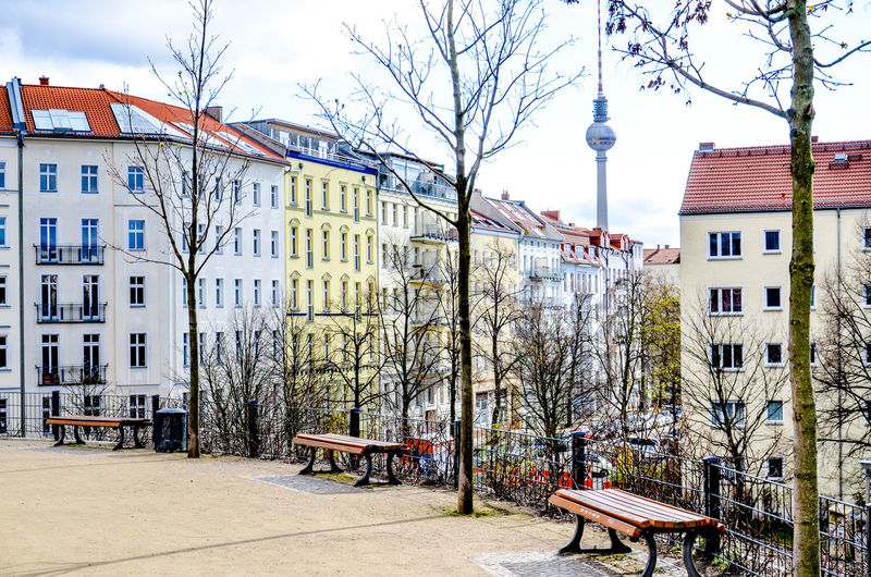 Berlin real estate panorama with historic buildings and park in foreground. Famous travel spot Berlin Berlin Photography Fernsehturm Home Panorama Quite Architecture Balcony Bare Tree Building Exterior Facades House Prenzlauer Berg Real Estate Residential Building Restored