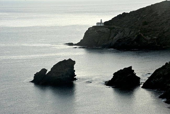 bay of Cadaques sea landscape view on lighthouse of Cala Nantes Cadaqués, Spain Cala Nantes Catalonia Cliff Costa Brava Day Landscape Lighthouse Nature No People Outdoors Rock - Object Rock Formation Sea Sea View Travel Pictures Waterfrontview