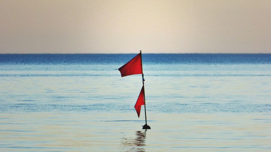 Sea Horizon Over Water Water Clear Sky Nature Beauty In Nature Sky Outdoors No People Scenics Flag Waterfront Tranquil Scene Tranquility Redflag EyeEm Gallery EyeEm Best Shots From My Point Of View Minimalism Taking Photos Getting Inspired Ostsee Germany