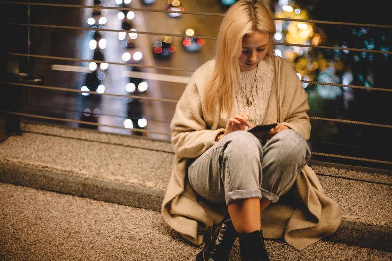 Full length of woman using mobile phone