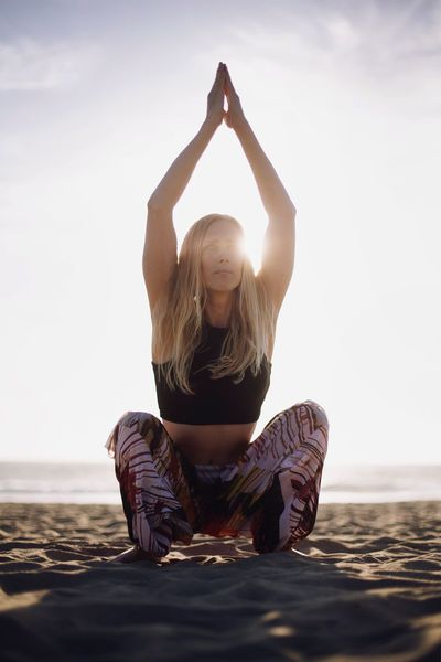 One Person Vitality Tranquility Beach Arms Raised Serene People Tranquil Scene Leisure Activity Blond Hair Lifestyles Nature Full Length Healthy Lifestyle One Woman Only Adults Only Sand Sea People Sky Young Adult Yoga