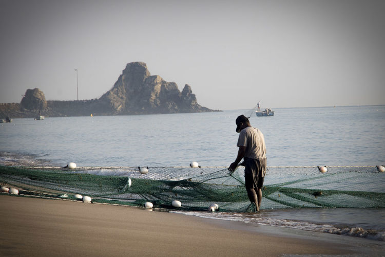 Fishing Net Fujairah Work Adult Adults Only Beach Clear Sky Day Fisherman Fishing Full Length Horizon Over Water Men Nature Net One Man Only One Person Outdoors People Real People Sea Sky Water