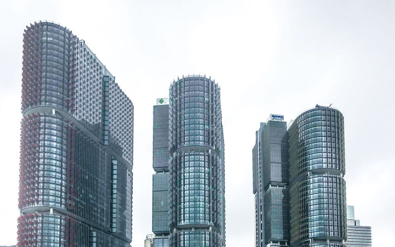 Small, medium and large City Cityscape Modern Urban Skyline Skyscraper Business Finance And Industry Sky Architecture Building Exterior Built Structure Office Building High Rise Tower Tall - High