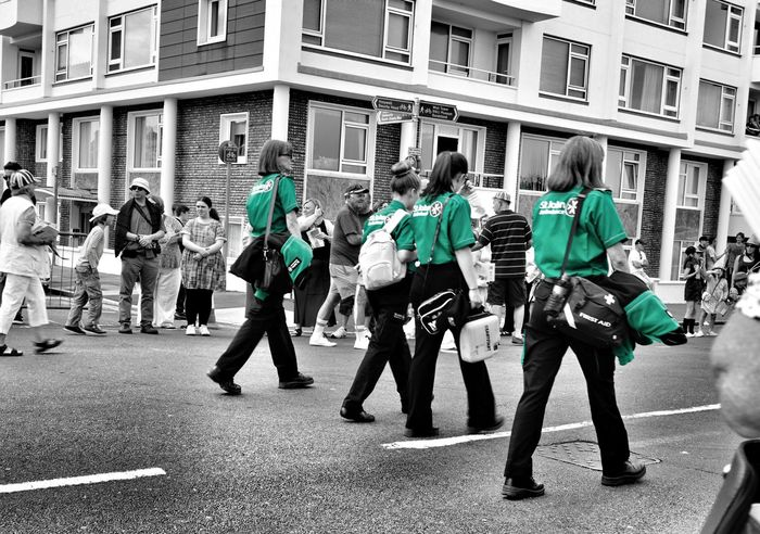 St. John ambulance girls Girls First Aid Scouts Moments On The Road People People Watching People Photography Blackandwhite Blackandwhite Photography Black And White Photography Colour Splash Green Color Green Uniforms Color Splash Walking Around People And Places. People And Places