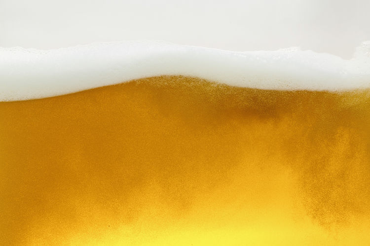 Golden weavy beer in a glass closeup Beer Beverage Bubbles Froth Wave Alcohol Backgrounds Beer - Alcohol Beer Glass Close-up Cold Temperature Condensation Drink Drinking Glass Foam Food And Drink Freshness Frothy Drink Full Frame German Beer Gold Colored No People Refreshment Texture And Background Yellow