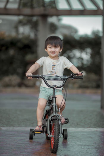 Play time!!! Eyeem Philippines The Week on EyeEm Bangs Bicycle Boys Casual Clothing Child Childhood Focus On Foreground Front View Full Length Innocence Land Vehicle Lifestyles Males  Men One Person Portrait Real People Riding Smiling Transportation Summer In The City