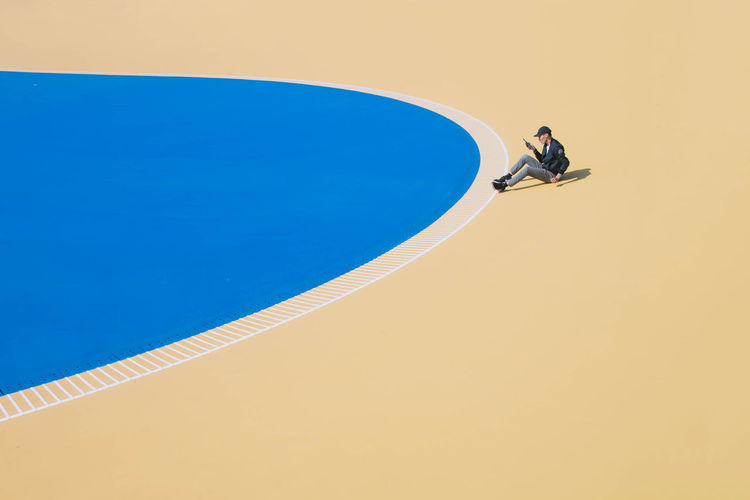 High angle view of man playing on swimming pool