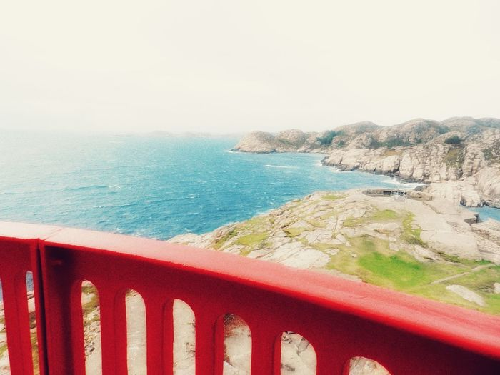 Lighthouse Lindesnes Norway Beauty In Nature Clear Sky Day Horizon Horizon Over Water Nature Nautical Vessel No People Outdoors Railing Red Scenics - Nature Sea Sky Tranquil Scene Tranquility Transportation Travel Water