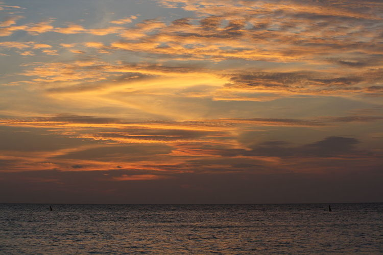 Sea with cloudy sky at sunset