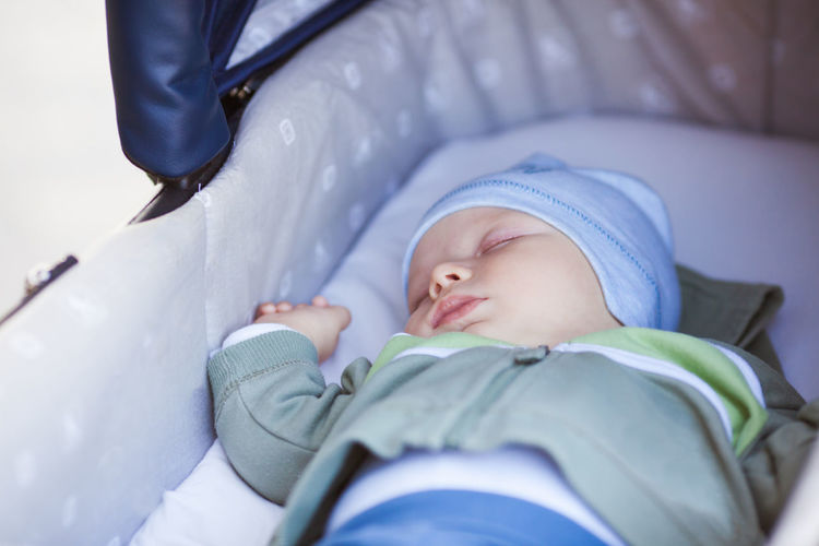 Cute baby sleeping in bed