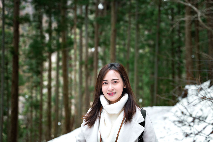 Portrait Tree Forest Young Adult One Person Winter Headshot Looking At Camera Cold Temperature Smiling Happiness Snow Land WoodLand Adult Long Hair Hair Nature Warm Clothing Hairstyle Beautiful Woman