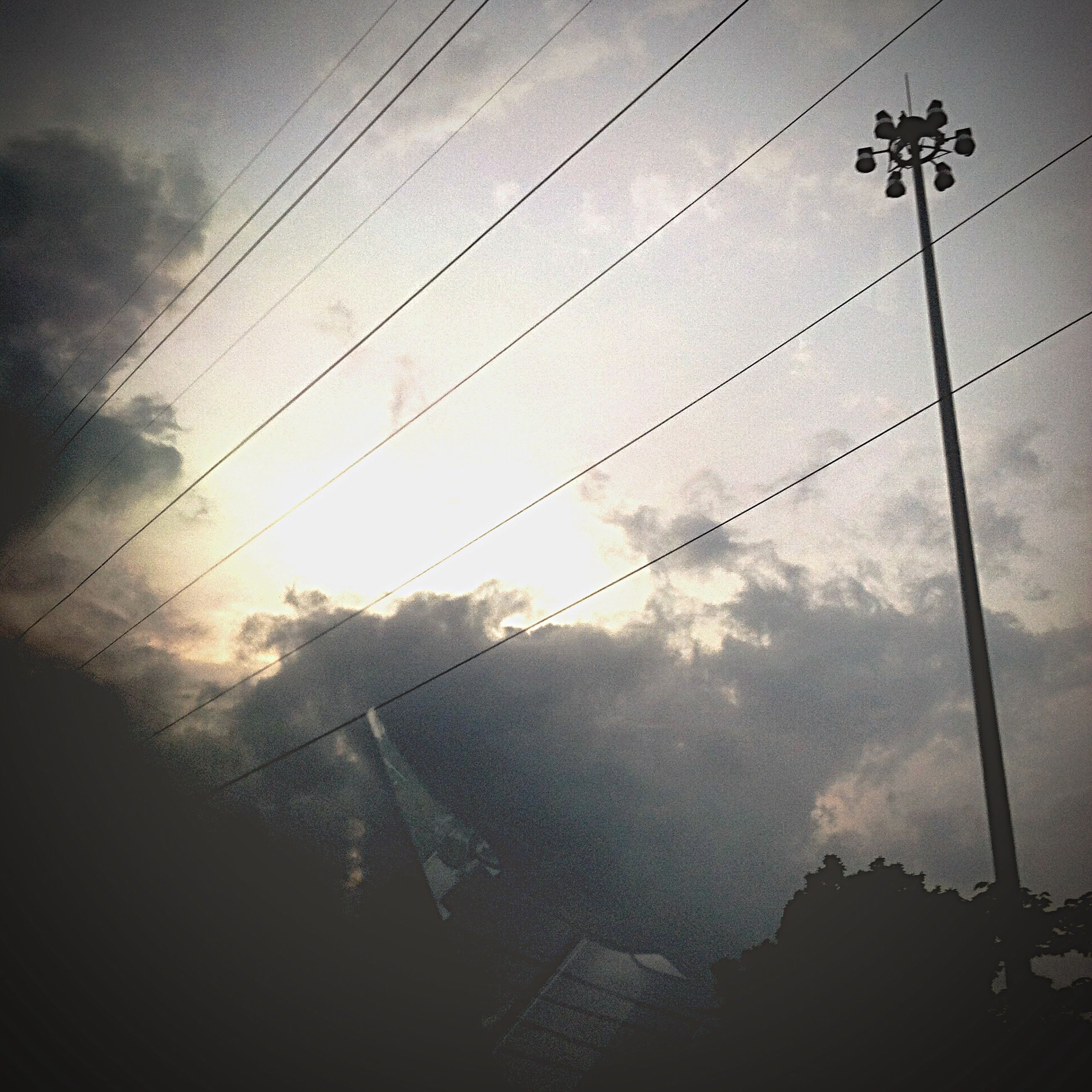 power line, silhouette, low angle view, sky, cable, electricity pylon, electricity, power supply, connection, cloud - sky, fuel and power generation, sunset, dusk, built structure, technology, power cable, pole, no people, outdoors, architecture