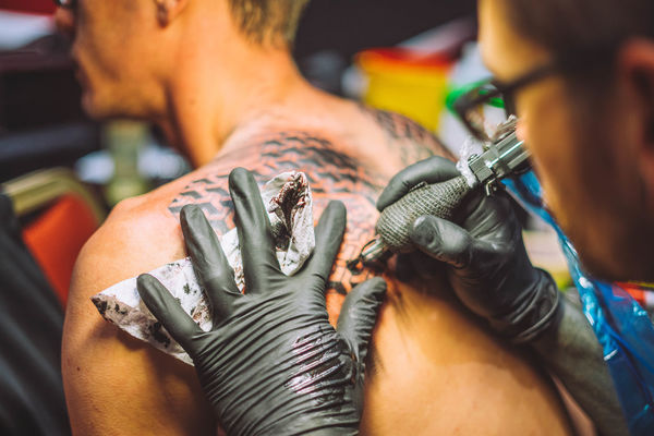 Close-up Customer  Day Human Body Part Human Hand Indoors  Lifestyles Men Occupation Real People Skill  Tattooing Two People Working Workshop