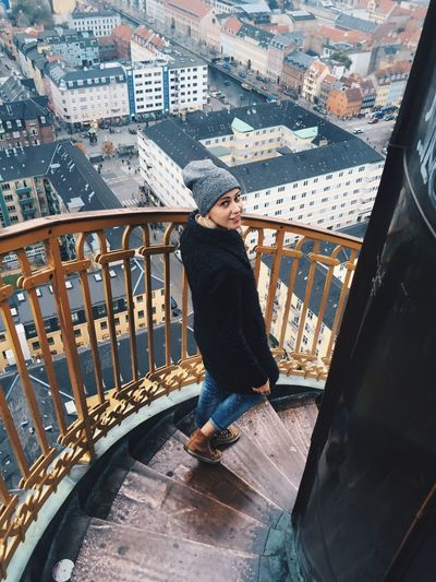 Woman On Staircase Above City