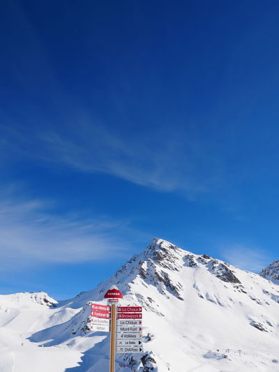 Signboard At Ski Resort Against Cloudy Sky