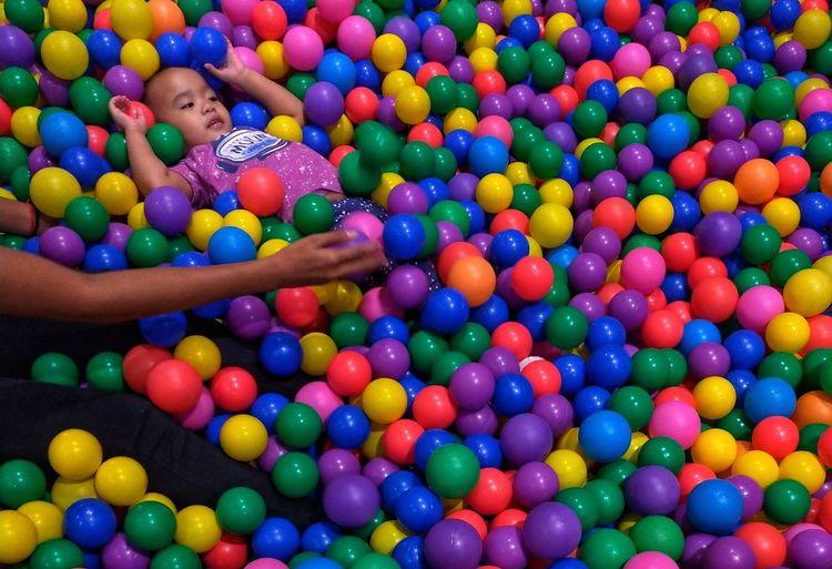 High angle view of girl playing with ball balls