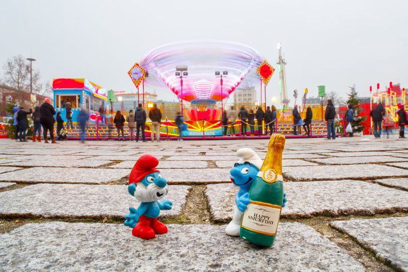 Happy New Year 2017 Happy New Year Smurf Smurfs Schtroumpfs Schtroumpf Smurfday Champagne Grand Schtroumpf Multi Colored Celebration Outdoors Chinese New Year Large Group Of People Traveling Carnival Full Length Cultures Sky City Childhood Happiness People Day Amusement Park Cityscape