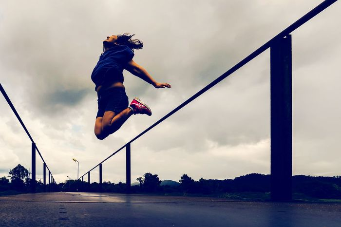 Jumping to be free from collateral & to have a good health, active lifestyle & self development concept on vintage background with free space Healthy Lifestyle Woman Stunt Sport Full Length Sports Clothing Jumping Extreme Sports Motion Activity First Eyeem Photo