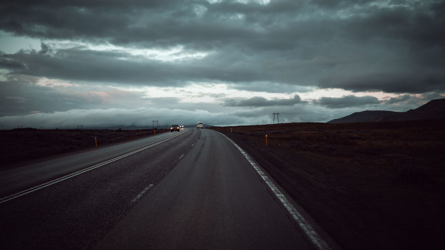 road iceland summer 24.00pm Iceland Cloud - Sky Sky Road Transportation Direction The Way Forward Sign Symbol Road Marking Marking Nature Overcast Diminishing Perspective Landscape No People Highway Environment vanishing point Storm Cloud Outdoors Dividing Line Ominous