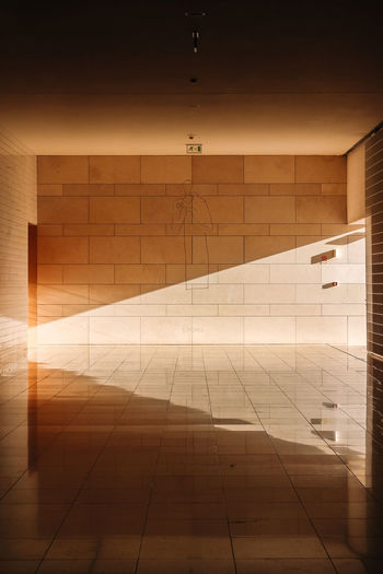 Reflection of building on tiled floor