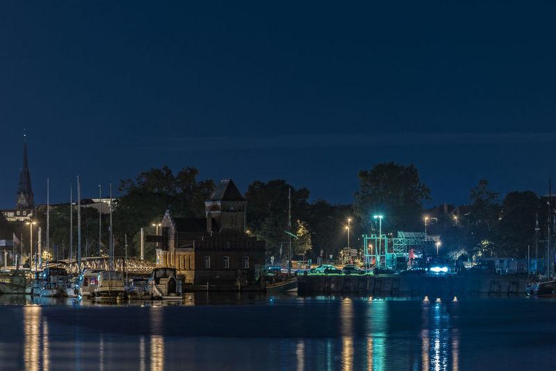 StadthafenLübeck Beauty In Nature Blue Boat City Harbor Idyllic Illuminated Illumination Lübeck Nature Night Nightphotography No People Outdoors Reflection River Scenics Sky Tranquil Scene Tranquility Untertrave Water Waterfront Waterreflections
