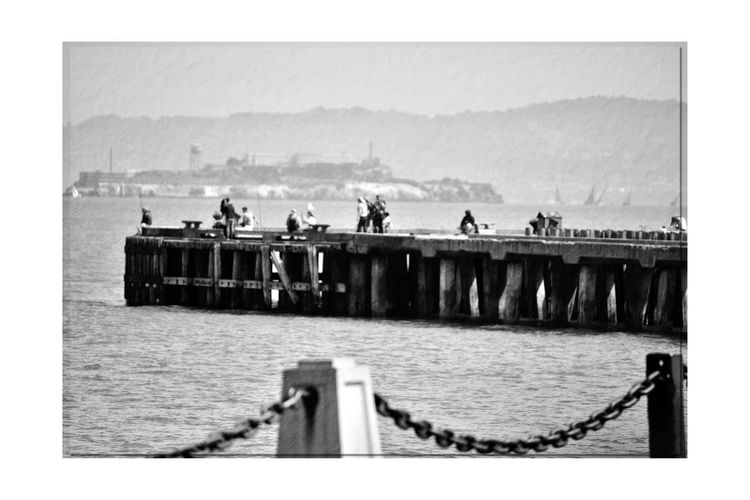 Torpedo Wharf 4 San Francisco CA🇺🇸 The Presidio Torpedo Wharf Pier People On The Pier Chain Barrier San Francisco Bay Background Alcatraz Island Silhouettes Sailboats Bnw_friday_eyeemchallenge Bnw_pier Monochrome Lovers Monochrome Vintage Black & White Black & White Photography Black And White Black And White Collection  Scenic Waterfront♥ Landscape_Collection Landscape_photography Water Sea Sky Harbor Historic The Past