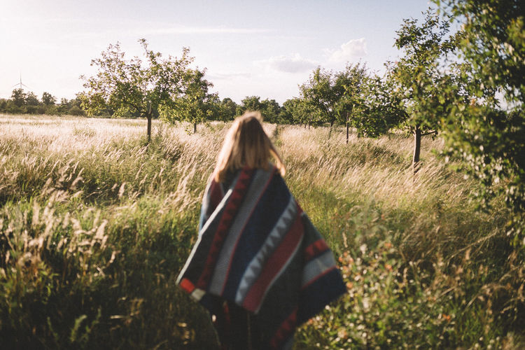 Out on a sunny day. Casual Clothing Day Exploring EyeEm Best Shots Field Germany Grass Landscape Landscape_Collection Leisure Activity Lifestyles Long Hair Nature Nature Outdoors Plant Sky Sunny Day Tranquility Traveling VSCO