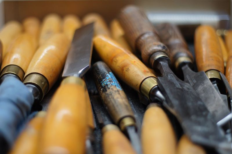 Close-up of chisels on table