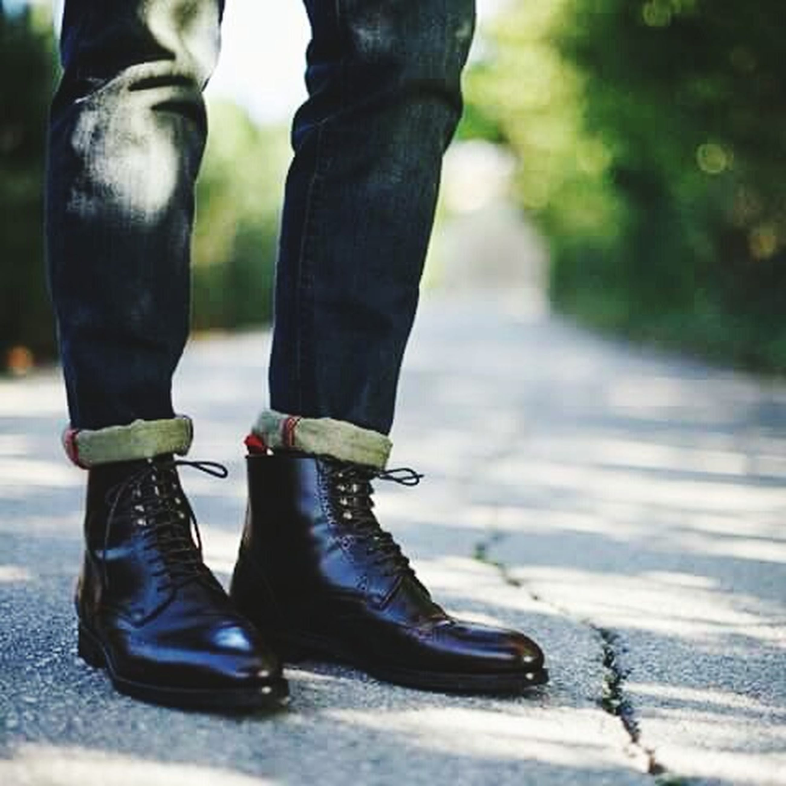 low section, person, shoe, lifestyles, standing, street, jeans, walking, footwear, casual clothing, men, focus on foreground, road, leisure activity, rear view, human foot