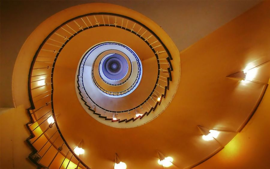 im Schneckenhaus 🐌🐚 Berlin Berliner Berlin Photography Frankfurter Tor Humana Runde Spiral Staircase Illuminated Spiral Staircase Architecture Built Structure Close-up Sky Steps And Staircases Stairway Hand Rail Spiral Stairs Stairs Steps Railing Skylight Electric Bulb Wall Lamp Hanging Light Electric Light Light Painting Historic Design Architectural Detail The Creative - 2018 EyeEm Awards The Architect - 2018 EyeEm Awards