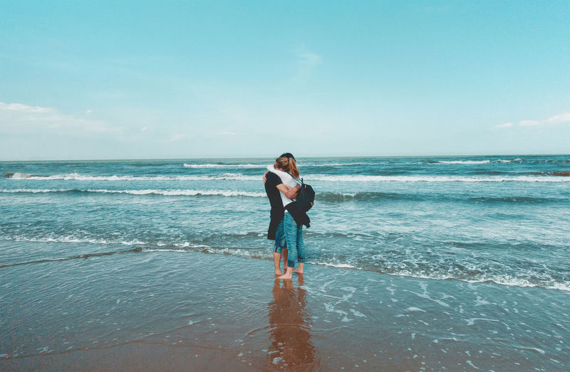Couple embraces at sea, hugs Beach Blonde Blonde Girl Countryside Day Heterosexual Couple Honeymoon Horizon Over Water Landscape Love Men Nature One Person Outdoors Real People Scenics Sea Sky Standing Togetherness Two People Vacations Water Young Adult Young Women