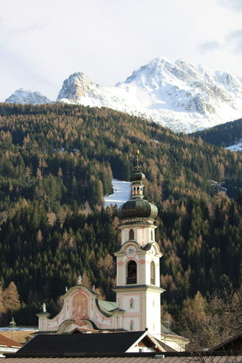 3XSPUnity Snowcapped Mountain Mountain Peak Mountain Austrian Alps Miles Away Close-up Winter Landscape Architecture Religion Clock Tower Tower Church Tower Church Details Art Is Everywhere Perspectives On Nature