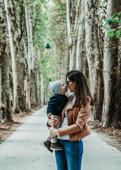 Mother and child love outdoors smiling