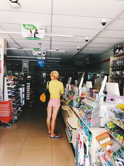 Full length of woman standing in store