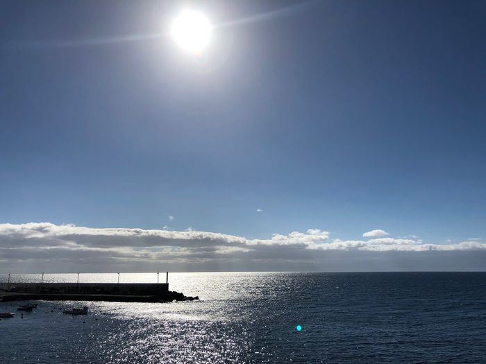 Sky Water Sea Scenics - Nature Beauty In Nature Horizon Horizon Over Water Nautical Vessel Transportation Waterfront Tranquil Scene Sun Lens Flare Nature Tranquility Sunlight No People Cloud - Sky Outdoors Day