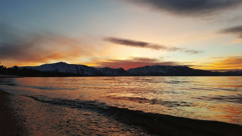 Sunset Reflection Water Outdoors Lake Dramatic Sky Landscape Cloud - Sky Mountain Sky Sand Beach Nature Beauty In Nature Lake Tahoe, Nv EyeEm Nature Lover Eyeemphotography EyeAmNewHere Colors Lake Tahoe, Ca WokeUpLikeThis Dramatic Sky Untouched Untouched Beauty South Lake Tahoe