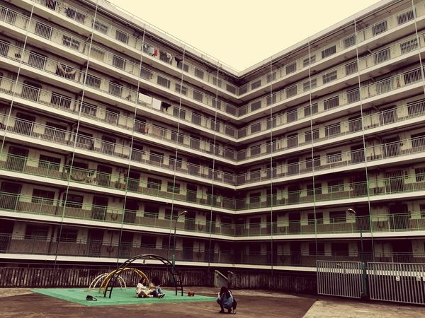 Playground Housing Estate Architecture Built Structure Real People Building Exterior Sitting People Day Large Group Of People City Lifestyles Travel Destinations Adult Adults Only Sky Outdoors Women