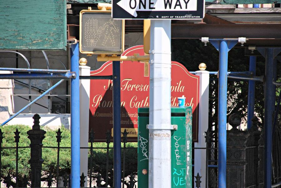 Poles, Signs, Posts, and Right Angles Letters Signs Clutter Streets City