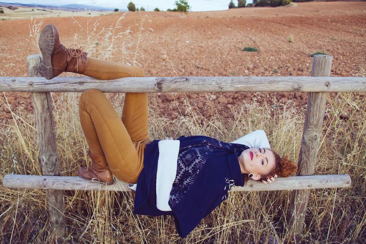 Portrait of young woman sleeping on grass