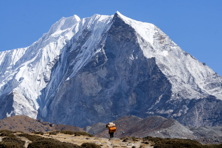 Scenic view of snowcapped mountain against sky, porter, nepal, himalaya, sherpa