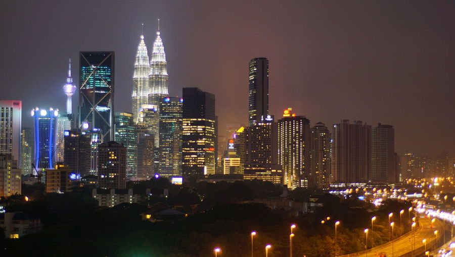 Malaysia city skyline illuminated at night. Architecture Building Building Exterior Built Structure City City Life Cityscape Financial District  Illuminated Landscape Modern Night No People Office Office Building Exterior Outdoors Residential District Sky Skyscraper Spire  Tall - High Tower Urban Skyline