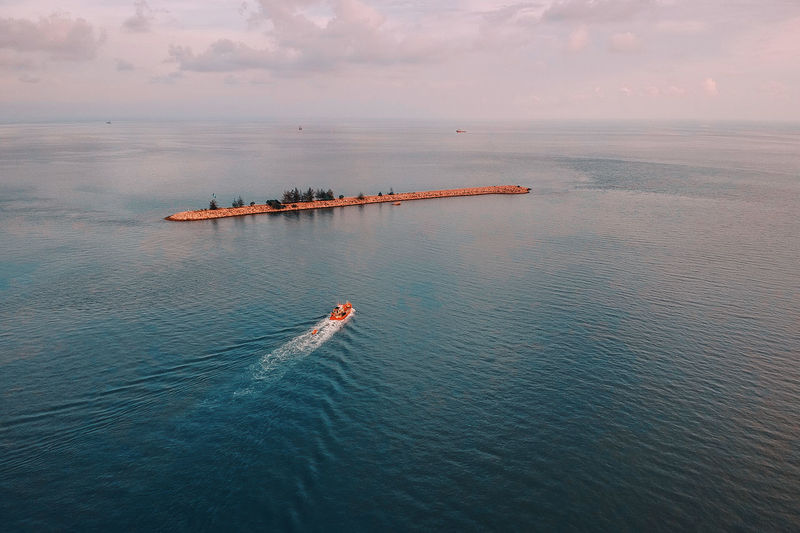 Beauty In Nature Cloud - Sky Day High Angle View Mode Of Transportation Motion Nature Nautical Vessel No People Outdoors Scenics - Nature Sea Sky Tranquil Scene Tranquility Transportation Travel Water Waterfront