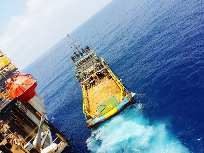 High Angle View Of Tugboat Sailing On Sea