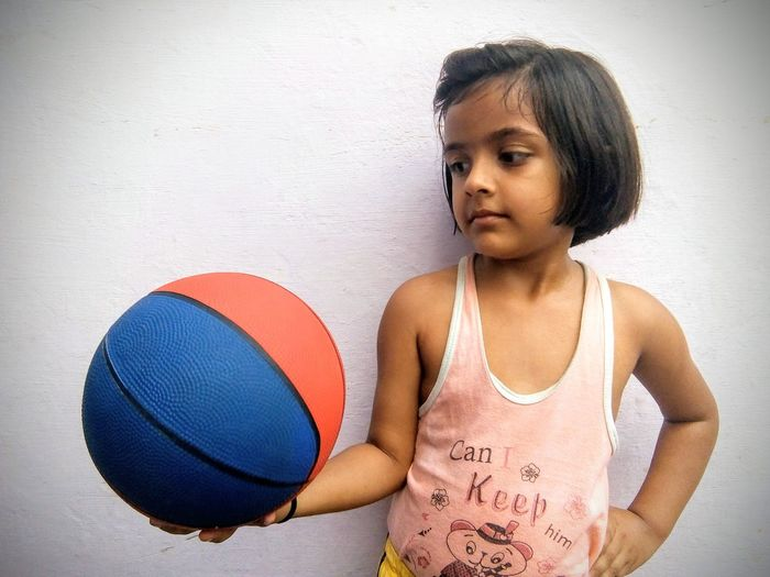 little girl looking at basketball Young Girl Girl Power Confidence  Confidant Young Girl Athletic Athlete Sports Sports Girl Indian Culture  Looking Away Basketball Player Looking At Basketball Basketball-ball Kid Indian Basketball - Sport Child Childhood Sport Portrait Competition Making A Basket Shooting At Goal Physical Education Basketball Basketball Hoop School Gymnasium Basketball Team