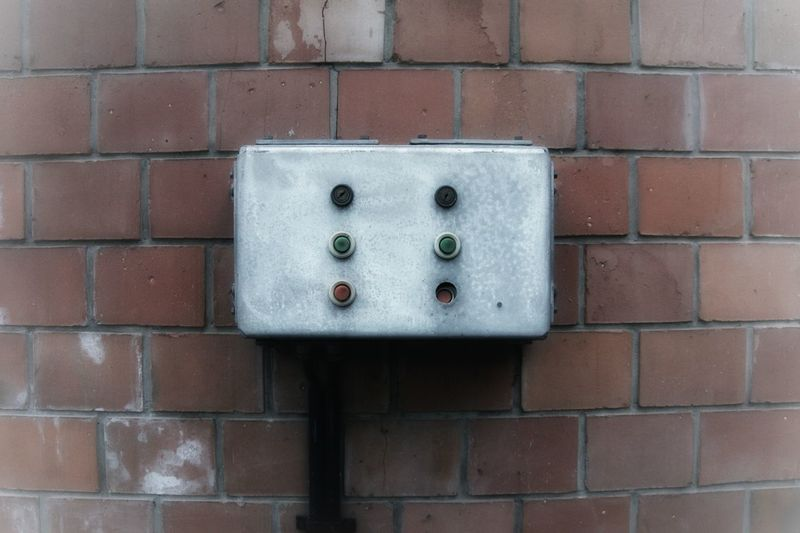 Close-up of mailbox on brick wall