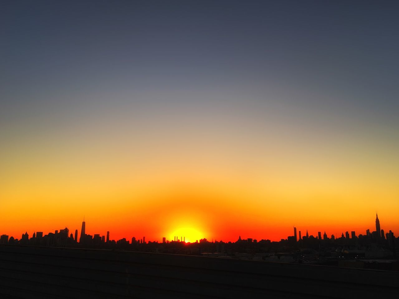 sunset, orange color, silhouette, building exterior, architecture, cityscape, skyscraper, city, built structure, travel destinations, nature, scenics, beauty in nature, outdoors, no people, sky, urban skyline, clear sky