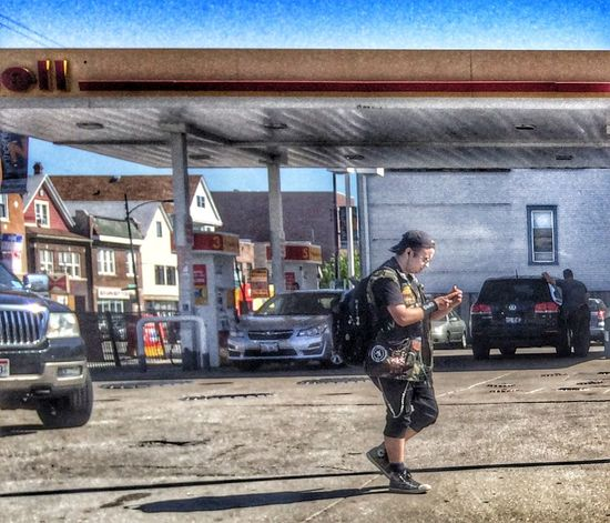 Street Photography Urban Landscape Streetphotography Streetphoto_color IPhoneography Street Corner Street Portrait Light And Shadow Gas Station People Watching
