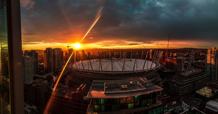 A panoramic view of BC Place at Sunrise Vancouver Sunshine Vancouverisawesome Vancouver Canada Vancouver BC Panoramic Cityscape No People Outdoors Urban Skyline Architecture Dramatic Sky Cloud - Sky Multi Colored Bcplace Travel Destinations Building Exterior Vancouverofficial Storm Cloud Architecture Illuminated Vancityhype City Sunset Illuminated