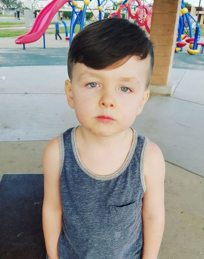 Can you stop taking pictures so i can go play? Lol. Cutekidsclub Cutekid Adorable BlueEyes Park Life Serious Face Annoyedface Cuteness MyBoy Myson Littleman Littlemonster Mybutthead