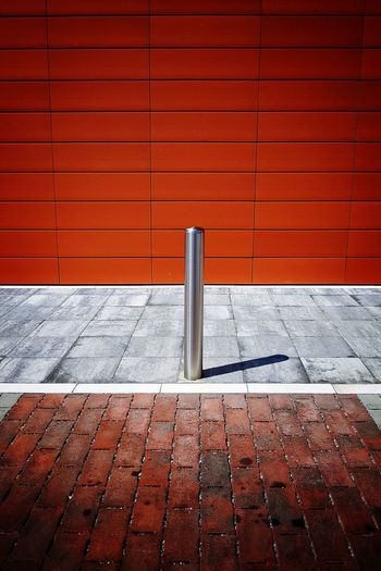 parking pole One 1 Single Object Architectural Detail Pole Parking Lot Parking Area Parking Area Red Close-up Architecture Paving Stone Pavement Stone Tile Cobbled Sidewalk Paved Parking Walkway Stationary The Architect - 2018 EyeEm Awards